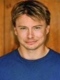 John Michaelson profil resmi