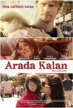 Arada Kalan (2012) afişi